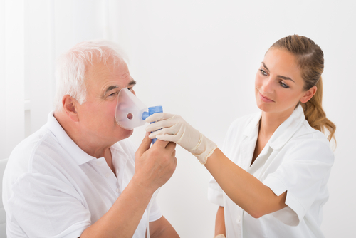 Female Doctor Looking At Senior Male Patient