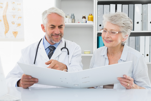 Male doctor with female patient