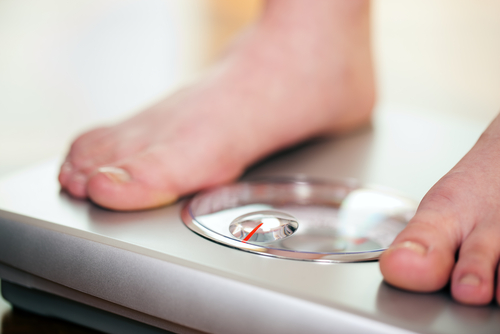 standing on bathroom scale