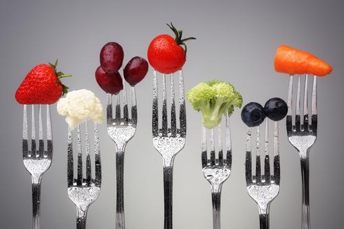 fruits vegetables on forks