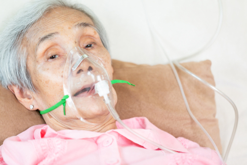 closeup senior patient with oxygen mask