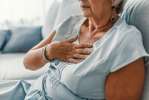 Woman having a pain in the heart