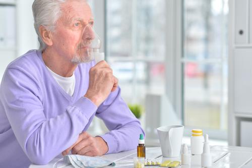 elderly man with inhaler